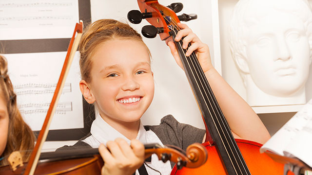 Girl Smiling Playing Cello